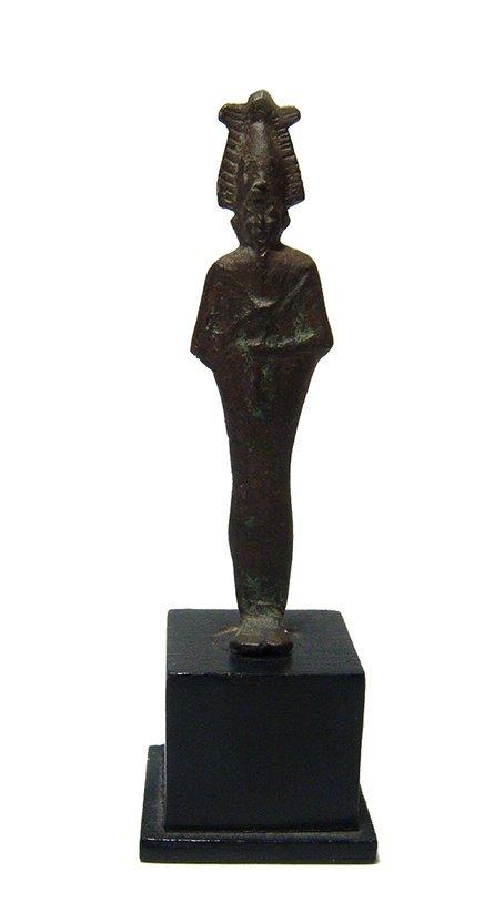 An Egyptian bronze votive figure of Osiris