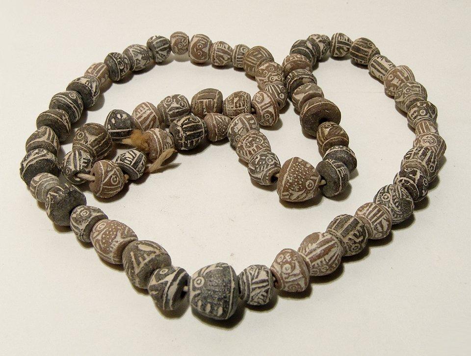 A strand of Pre-Columbian terracotta beads, Ecuador