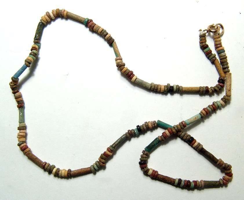 A strand of Egyptian multicolor faience beads