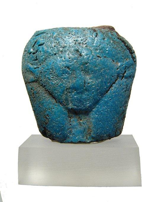 An Egyptian faience turquoise glazed head of Hathor