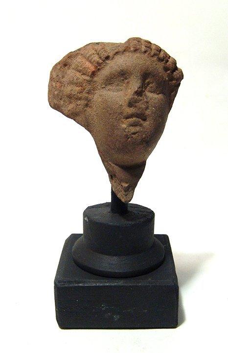 A Greek terracotta head of a lady