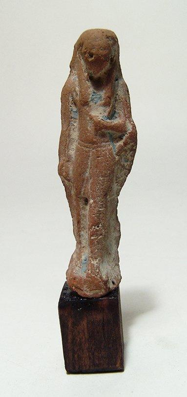 An Egyptian terracotta figure, Late Period