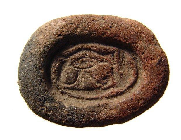 An Egyptian faience Eye of Horus amulet mold