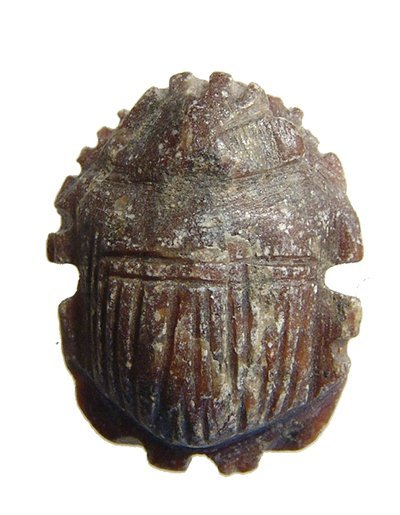 An Egyptian stone button scarab, Late Period