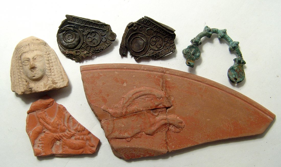 A mixed group of ancient ceramic and metal objects