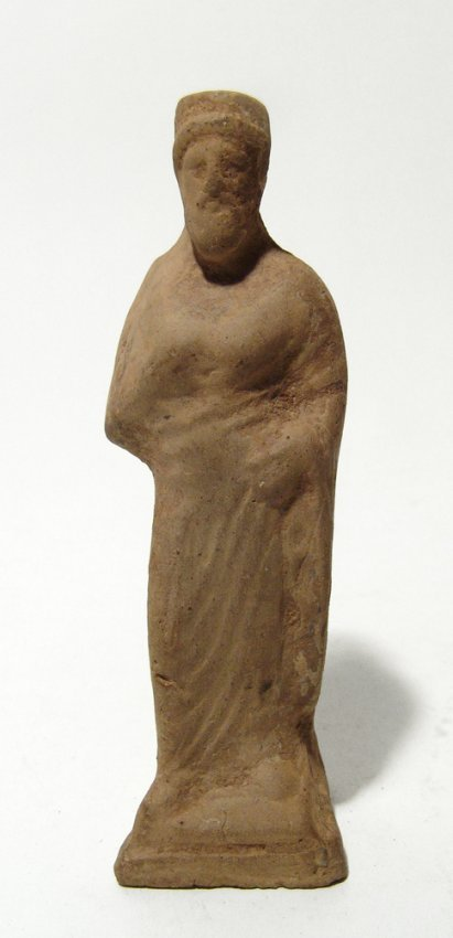A Greek terracotta figurine of a robed man