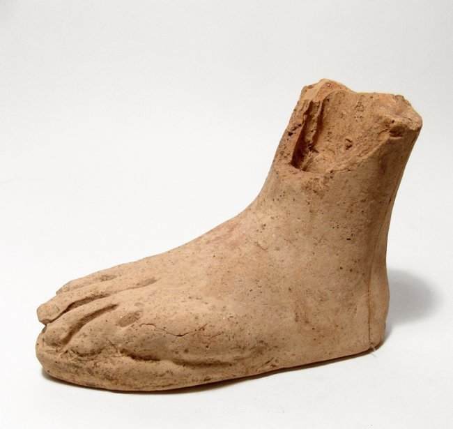 A life-sized Etruscan terracotta left foot