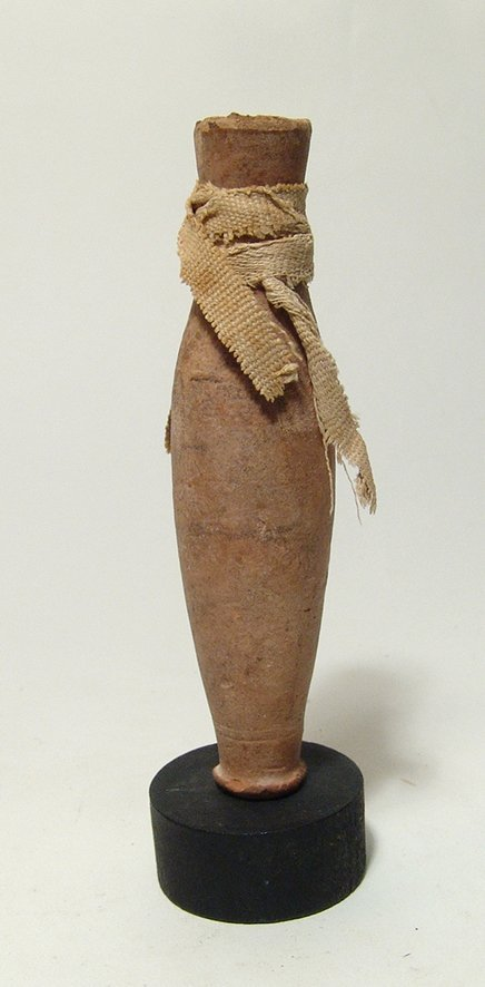 An Egyptian ceramic votive flask, New Kingdom