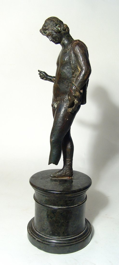 Magnificent Roman bronze figure of a youth