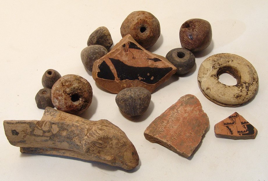 Mixed group of pottery fragments and spindle whorls