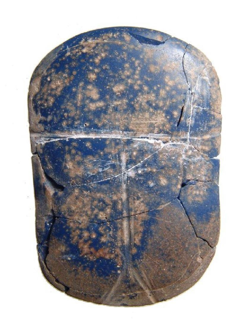 An Egyptian blue glass scarab, Ptolemaic