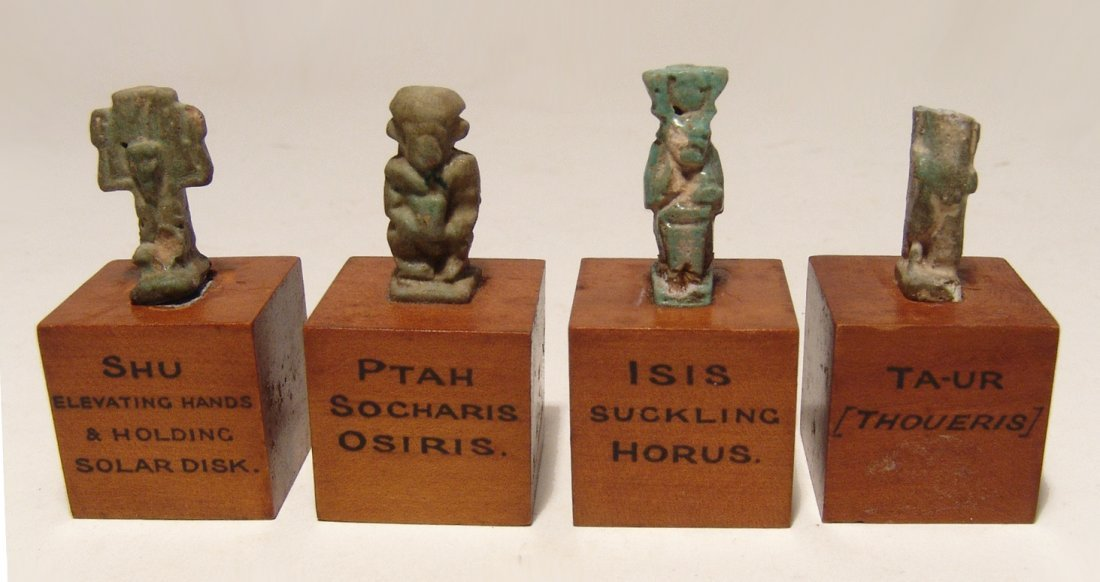 A collection of 4 small Egyptian faience amulets