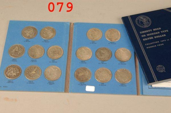 79: 2 coin books Morgan dollars