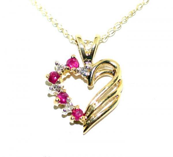 4: 0.25 CT Diamond and Ruby Heart Pendant