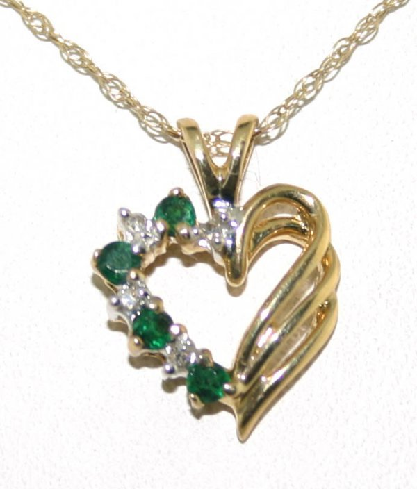 5: 0.25 CT Diamond and Emerald Heart Pendant