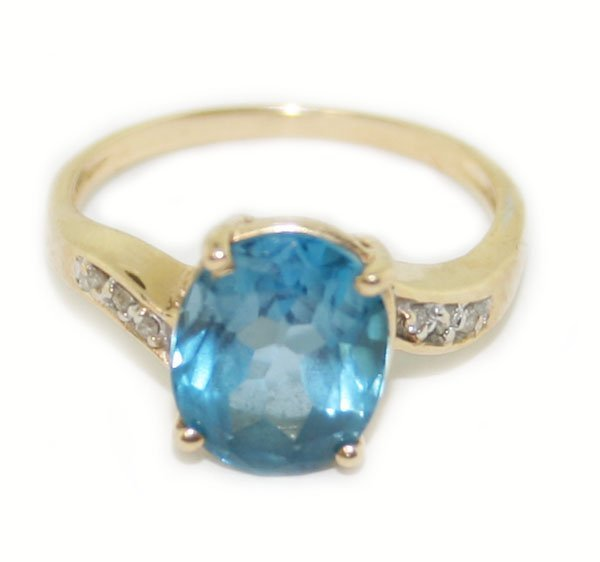 14k y/gold diamond & blue topaz  ring