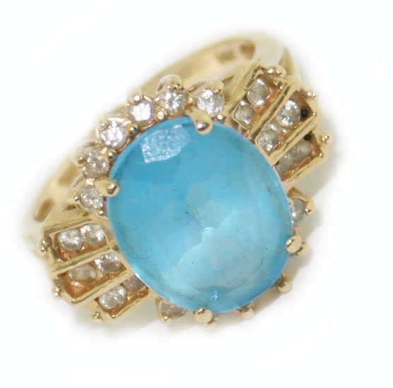 14k yellow gold diamond & blue topaz ring .