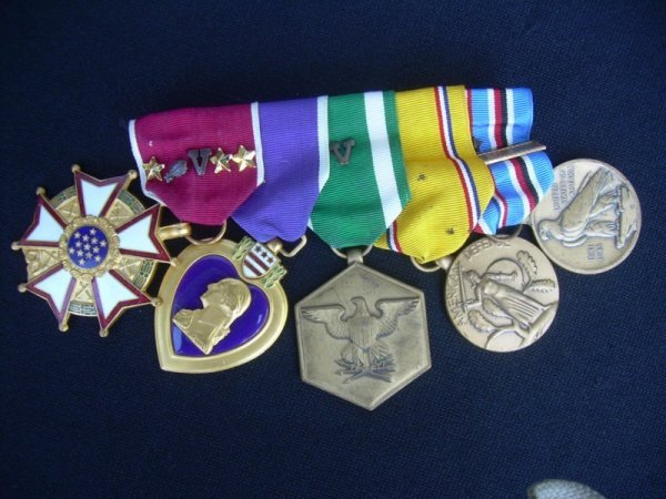 11: Adm. A. Burke's Five Medals