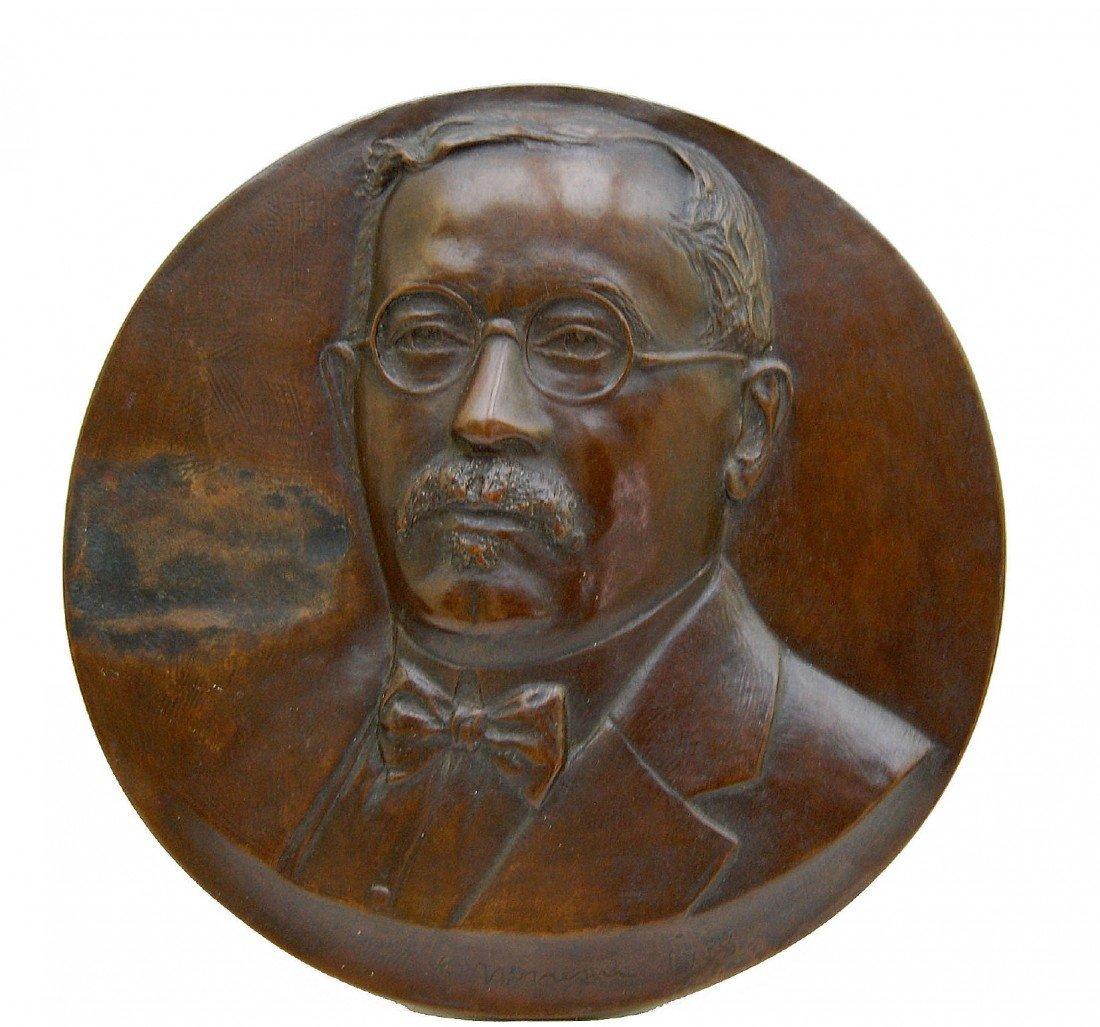 120: Bronze plaque of man, James Novelli, 1933
