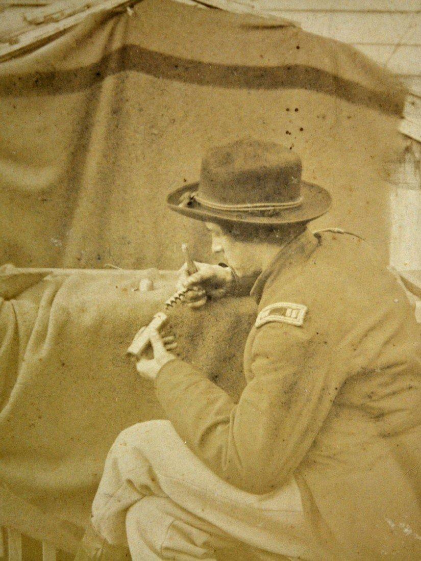 590: Albumen Photo - Civil War Captain holding auger