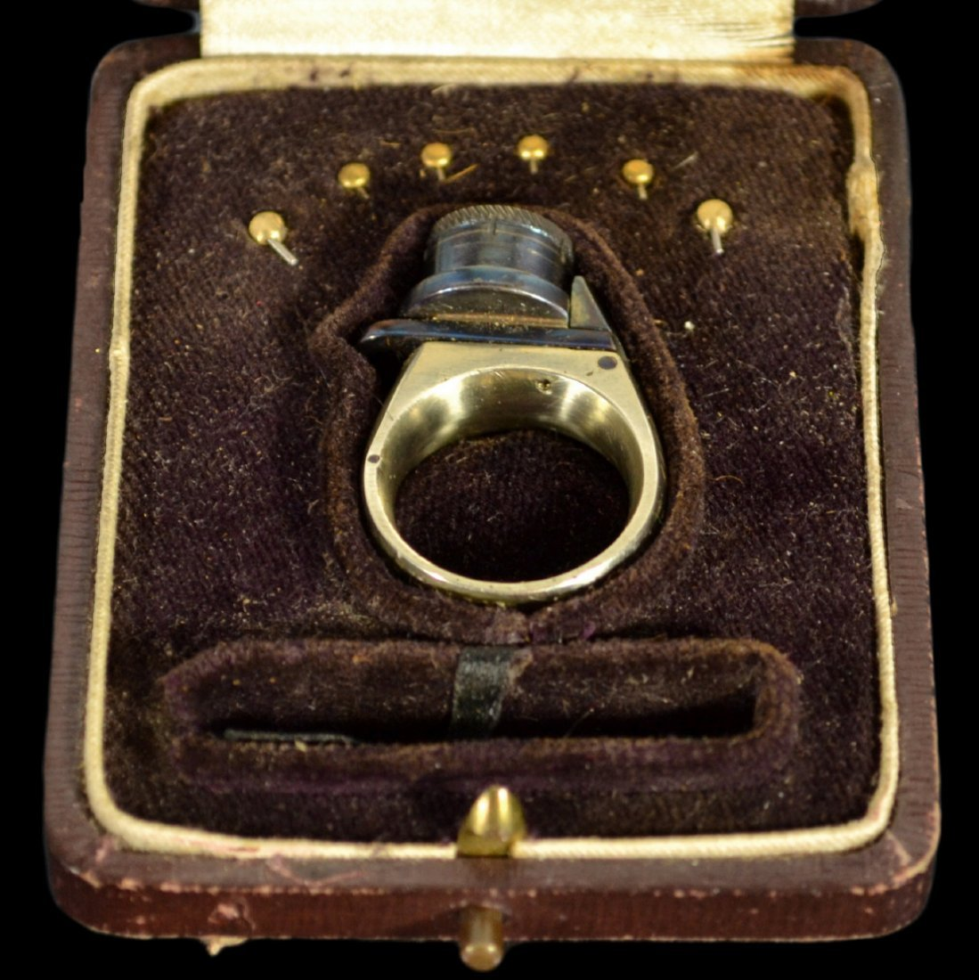 "Ring, Revolver, in case, ""Le Femme Fatale"""