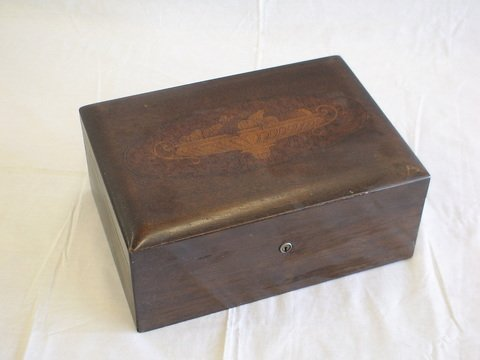 1010: Walnut humidor, lined with decorative hinged lid.