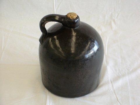 1016: Vintage dark brown 'moonshine' or whiskey jug