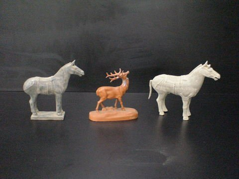 3006: Lot of 3: Two highly carved horses, one horse has