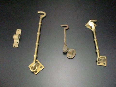 3015: Set of 3 brass or metal door clasps. Average 6 to