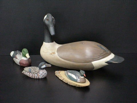4003: Set of 4 ducks: 3 wooden ducks, one is a mounted