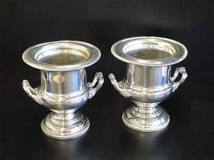 Pair of Chippendale style heavy wine urns, marked