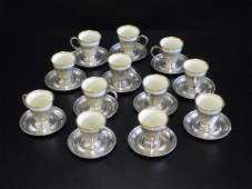 1101 Set of 12 Demitasse cup holders with gold trimme