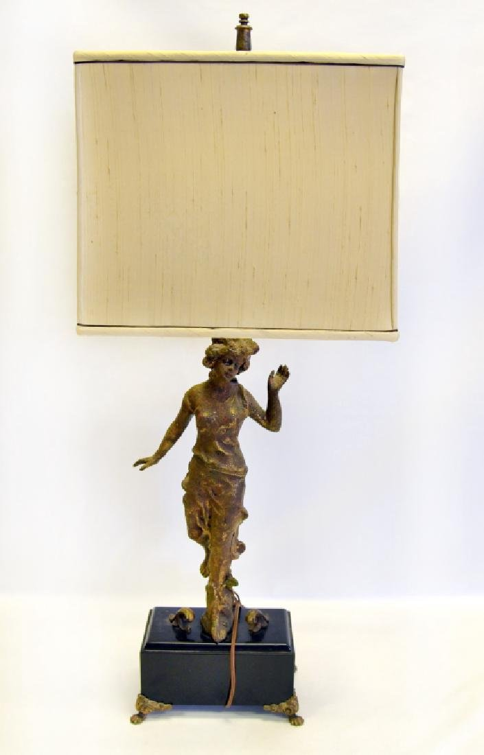 Classical Figural Lamp Raised on Black Block