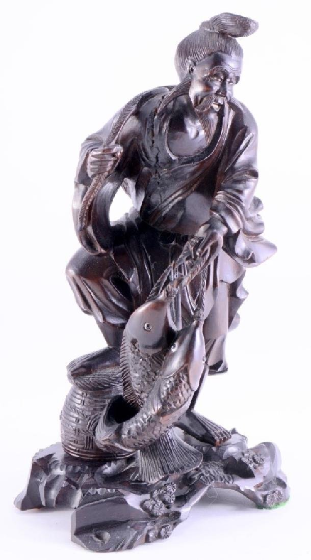 Oriental Carving of Fisherman w/Catch