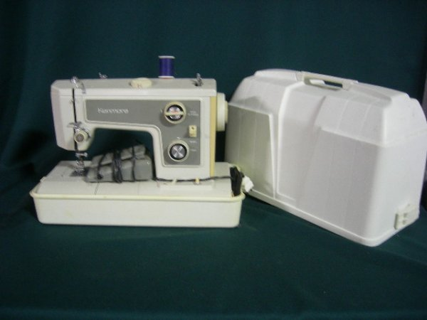 13: KENMORE PORTABLE SEWING MACHINE