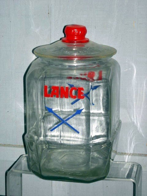 17: COVERED LANCE ADVERTISING JAR