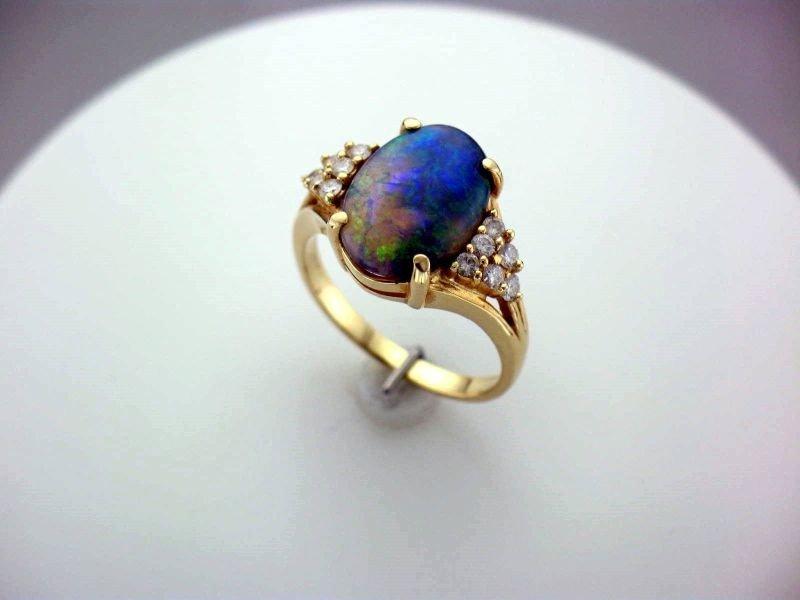 75: BLACK OPAL AND DIAMOND RING
