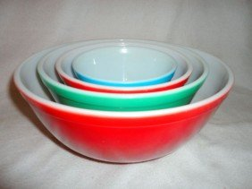 20: FOUR PYREX OVEN WARE NESTING BOWLS