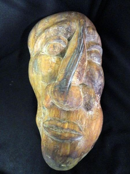 9: WOODEN CARVED FACE