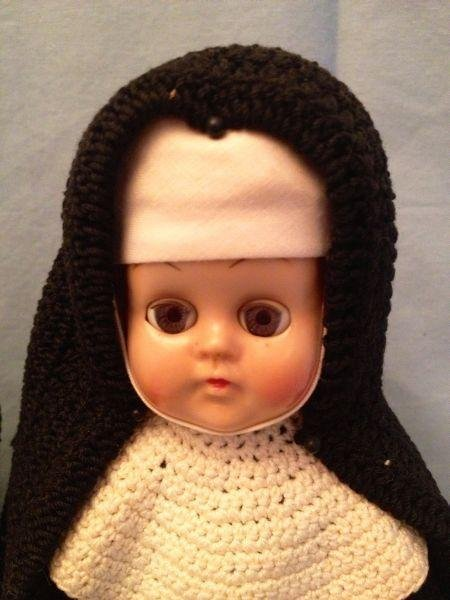 12: Hard Plastic Walking Nun Dolls