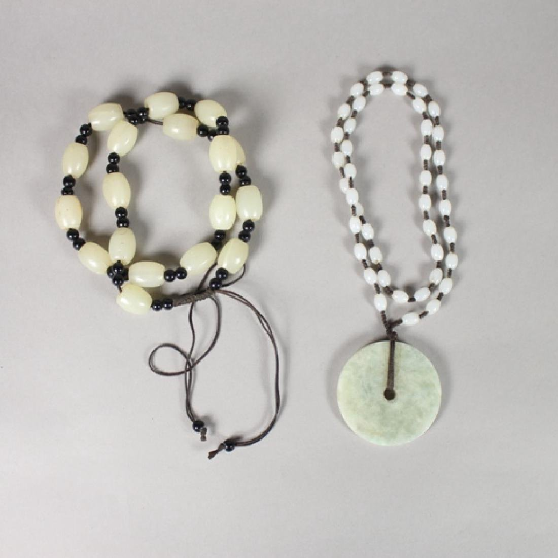 White Jade Beaded Necklaces with Figural Pendants
