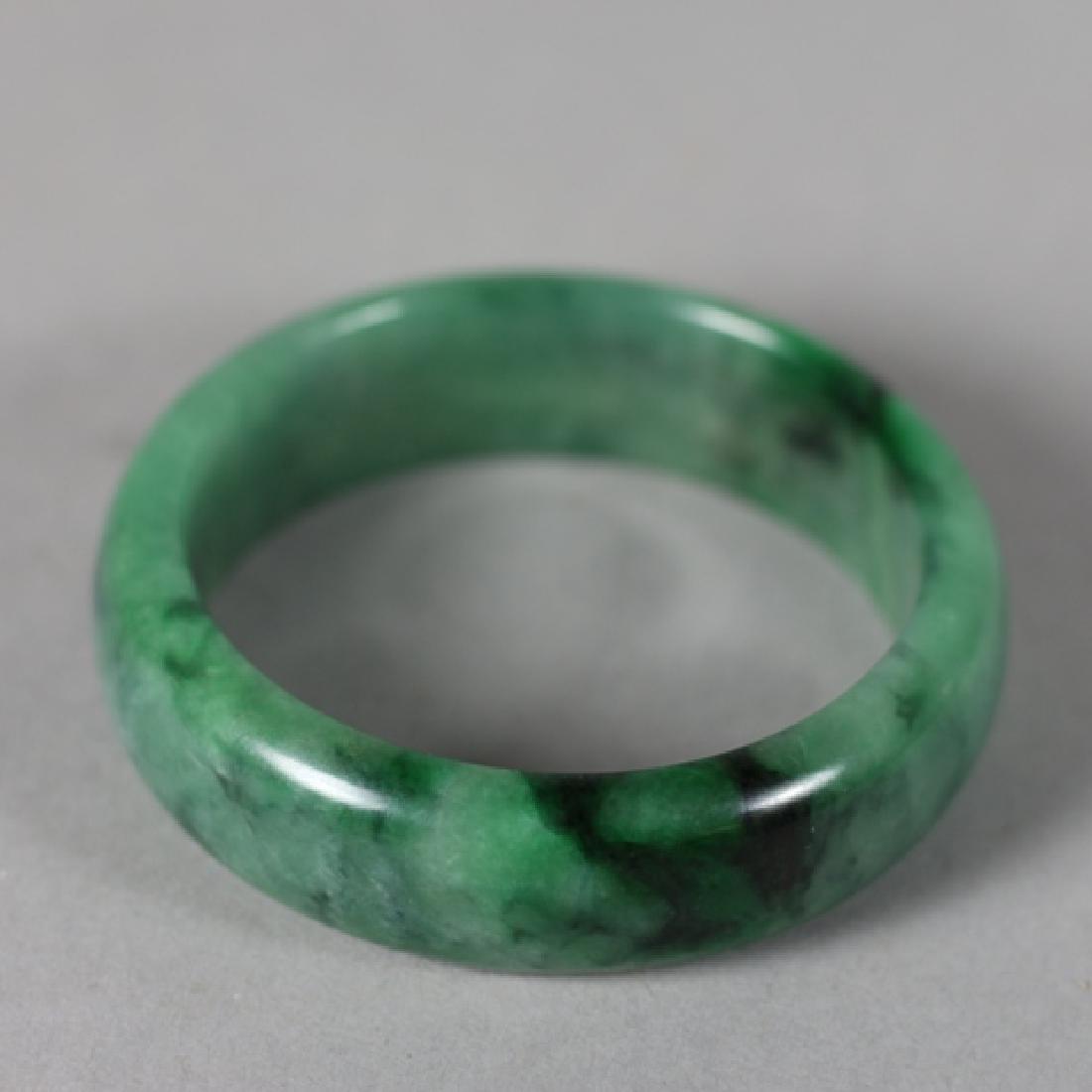 Three 20th Century Jade Bangles and Napkin Ring - 3