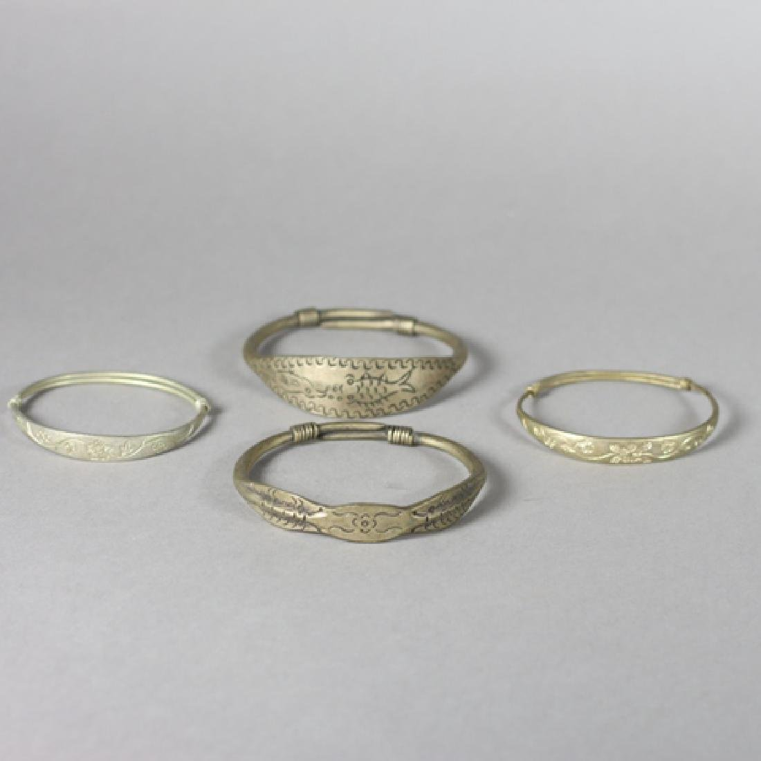Four Antique Chinese Brass Bangles