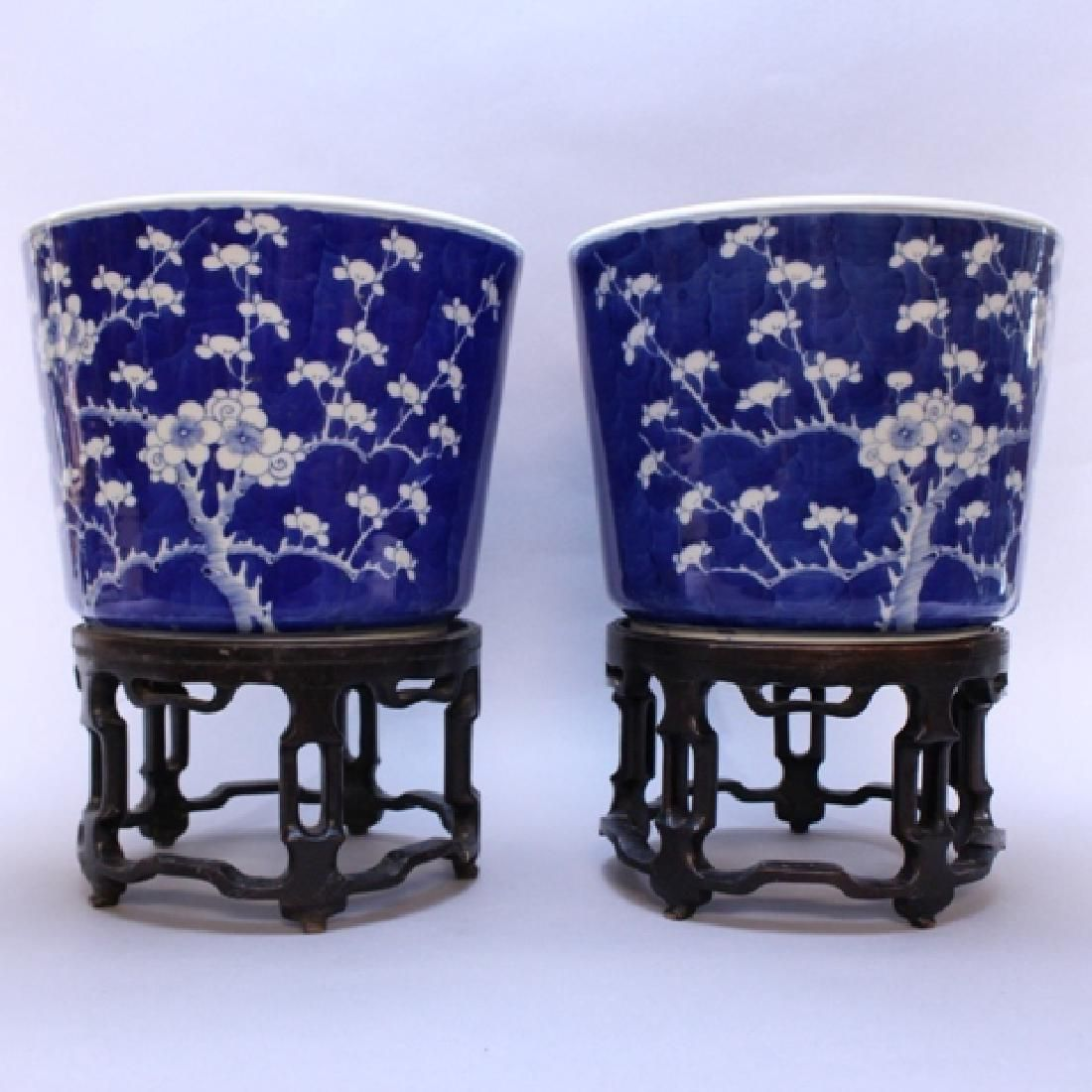 Pair of Chinese Blue and White Planters on Stands