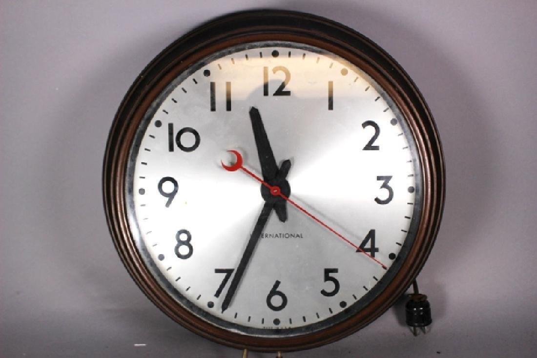 Vintage Cast Metal International Wall Clock