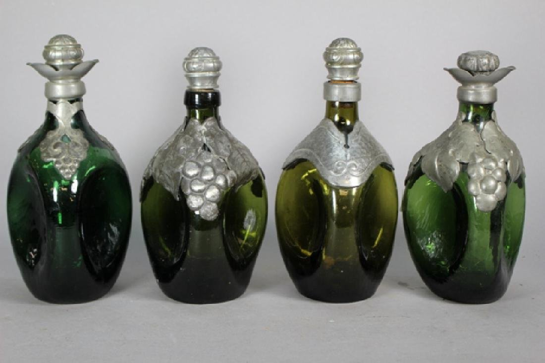Four Danish Pewter Overlay Pinched Decanters