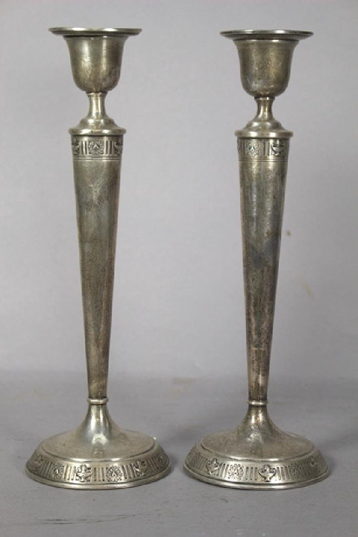 Pair of Adams Style Sterling Silver Candle Sticks