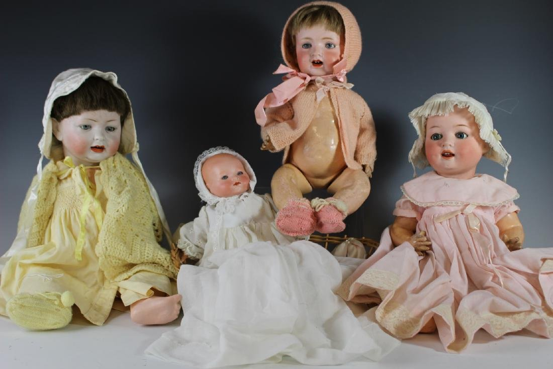 Four Antique German & Japanese Bisque Dolls
