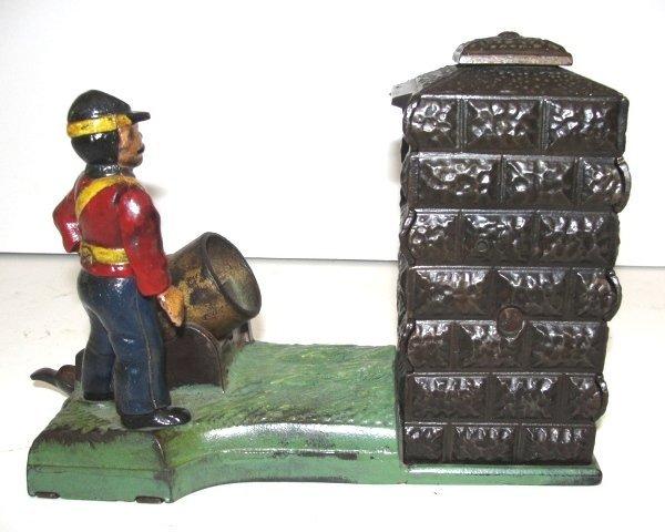 J&E Stevens Cast Iron Mechanically Artillery Bank - 6