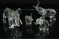 FOUR SWAROVSKI CRYSTAL ELEPHANTS